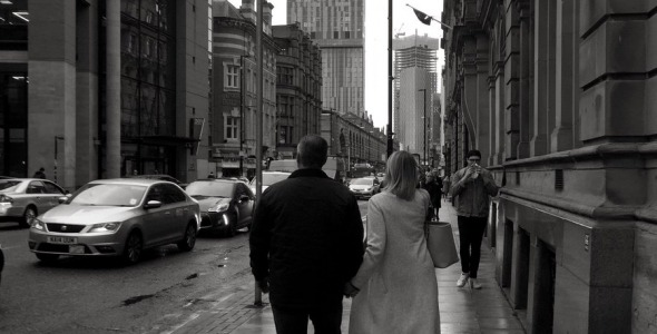 Couple on Deansgate at rush hour